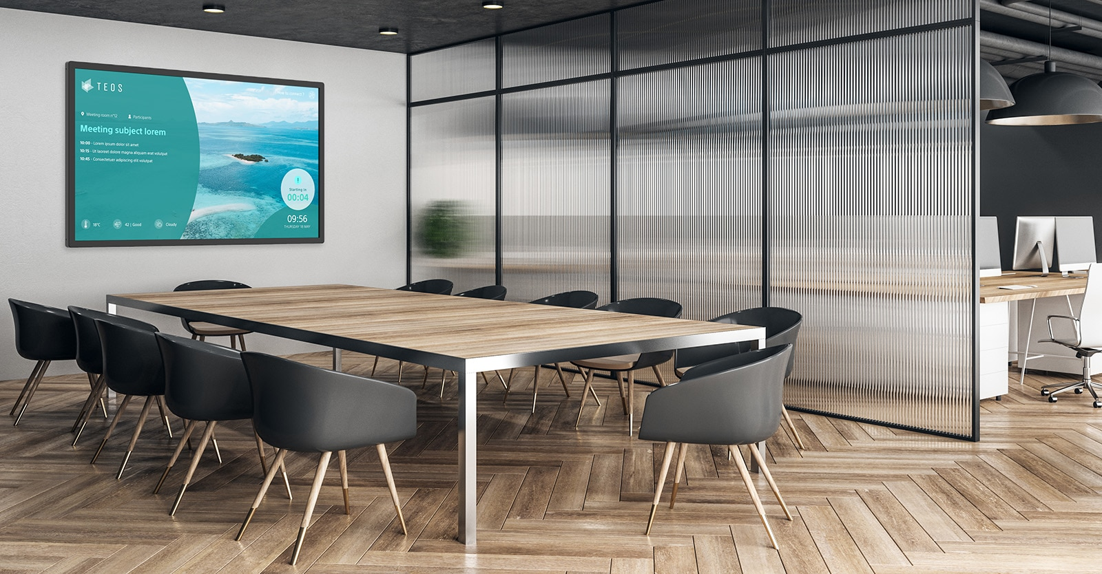 An empty corporate meeting room with a BRAVIA professional display attached to the wall