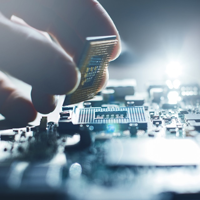 Chip being placed onto a circuit board