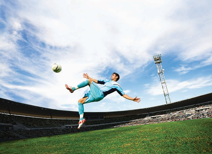 A soccer player playing soccer