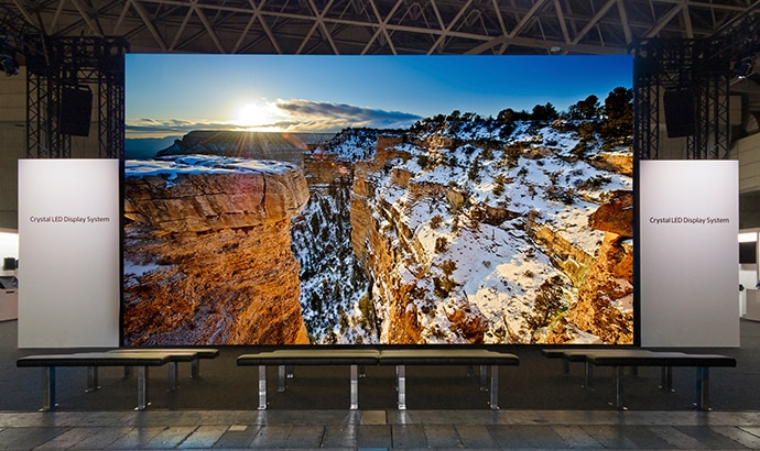 An image of a CLED display at a trade show with an image of a canyon on the screen
