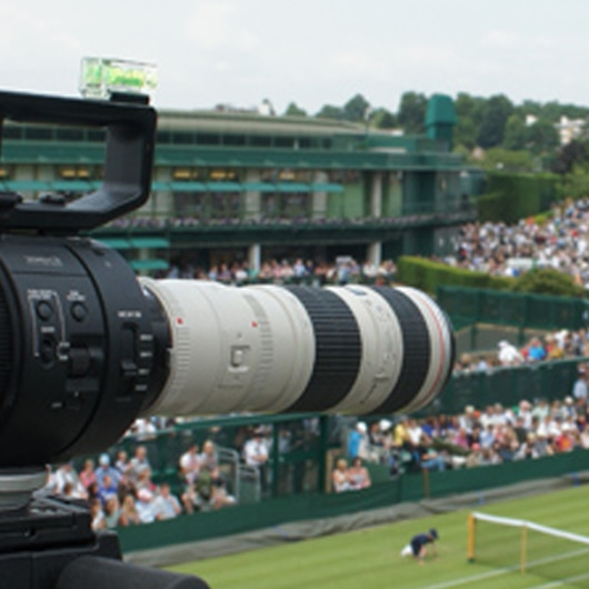 Sony 4K Camera with zoom looking into wimbledon court