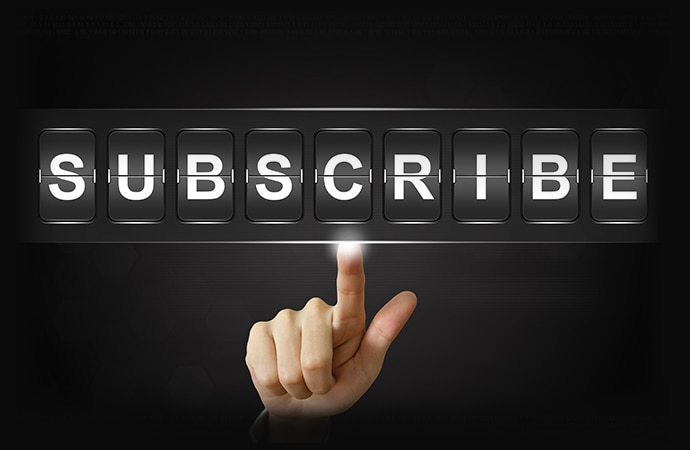 A finger clicking subscribe button