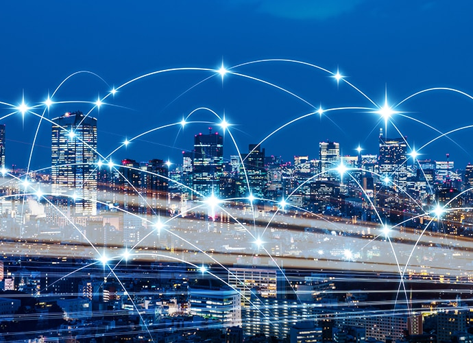 Image of a city scape with interconnected digital cloud services