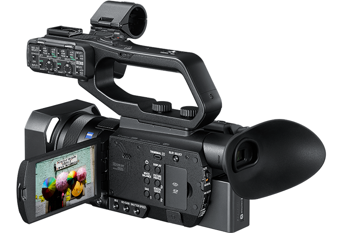 Side view of HXR-NX80 with LCD screen on and media slots open