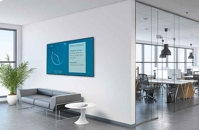 A corporate reception area with a BRAVIA on the wall displaying the time and other information