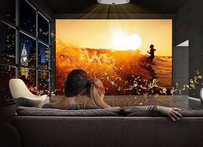 Couple on sofa enjoying a show using Sony's projector