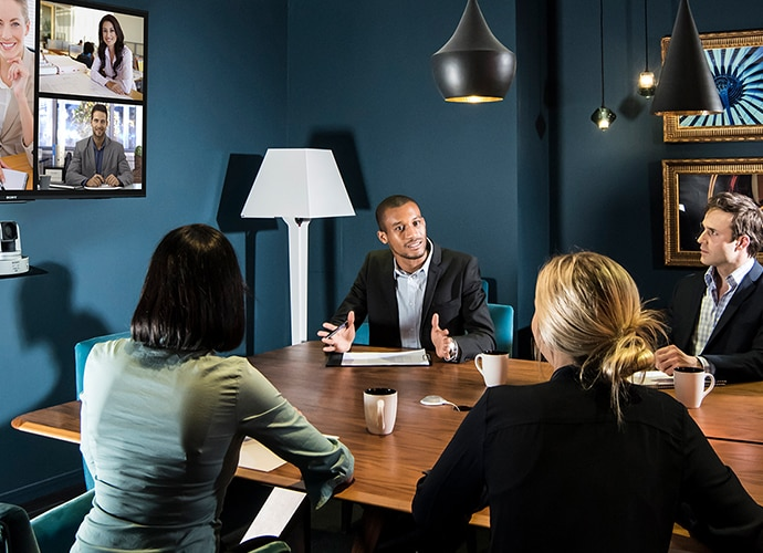Meeting being held in a meeting room and virtual call