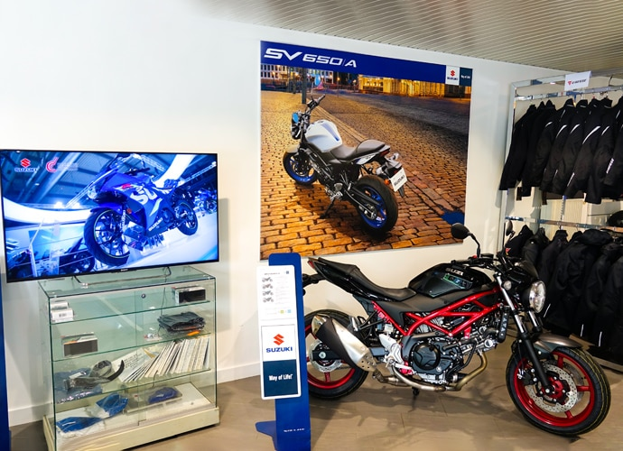 Image showing the interior of the Suzuki motorcycle showroom, with a BRAVIA display set up for digital signage.