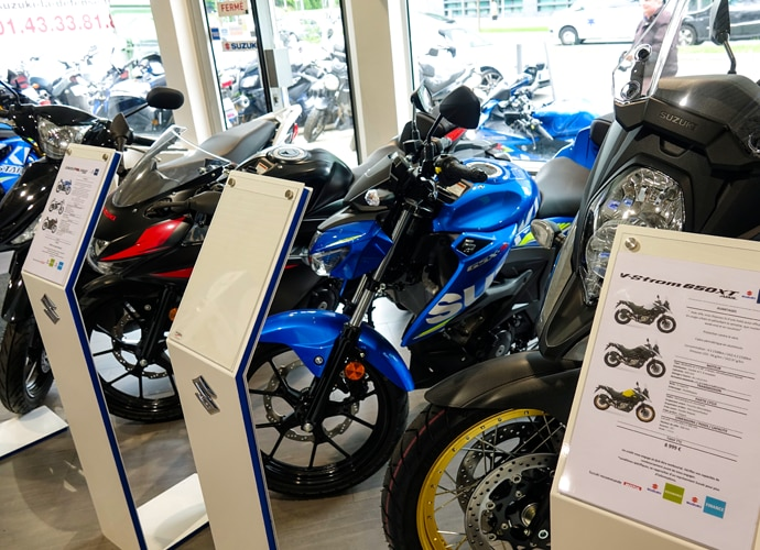 Image showing the interior of the Suzuki motorcycle showroom, with a close-up on one of the bikes.