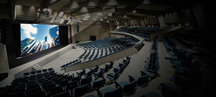 A corporate auditorium with a projected image on a large screen