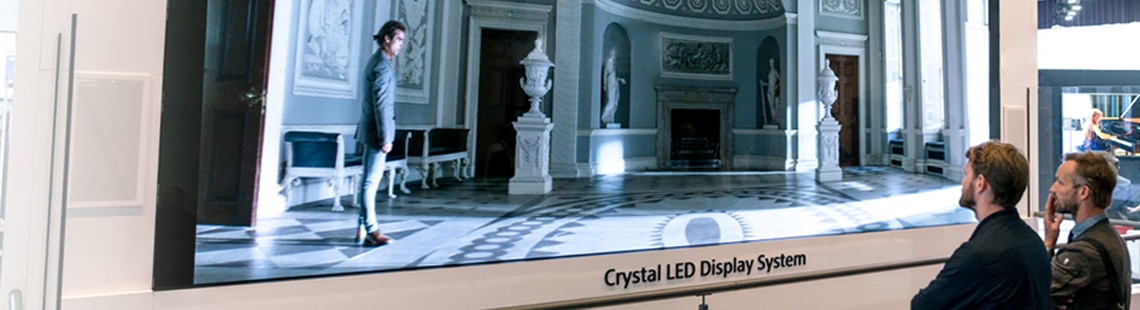 Crystal LED video walls for manufacturing and automotive, people viewing big screen display system
