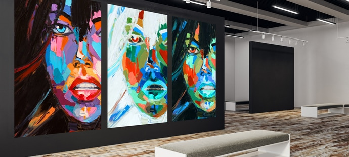 A piece of art is projected against a wall in a museum.