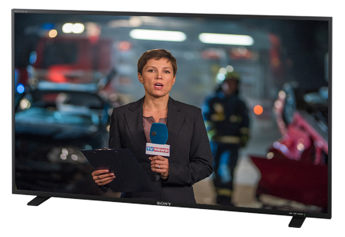 Female journalist reporting on a Bravia screen