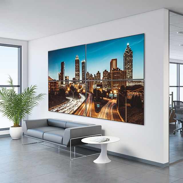 A corporate lobby with a large TEOS display mounted on the wall