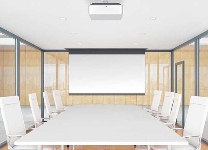White boardroom with clear glass walls and projector hanging from the ceiling.