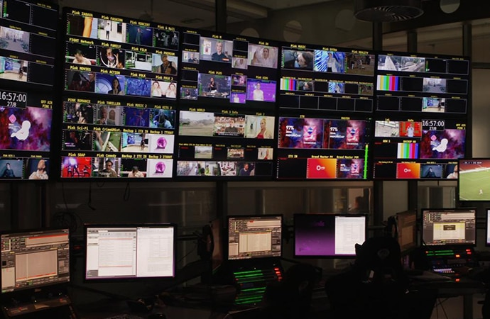 6 monitors with many production shots on the monitors