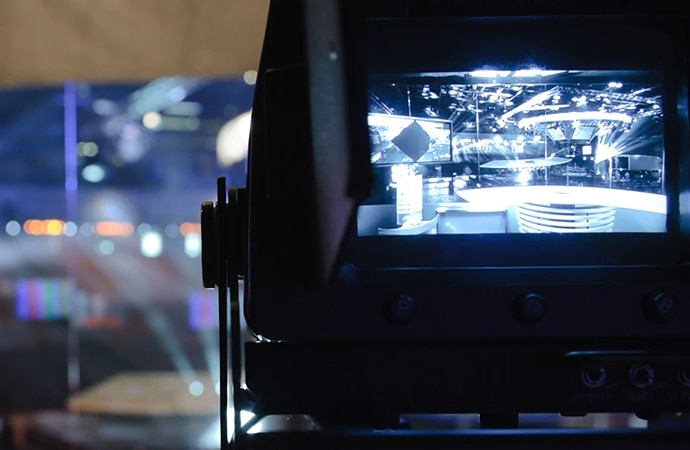 A shot looking through a Sony camera at a news desk
