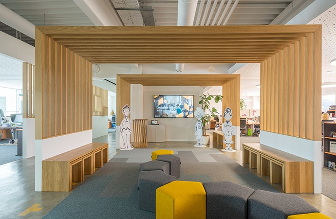 Interior of Sony DADC's modern office. A display with TEOS is visible in the background.