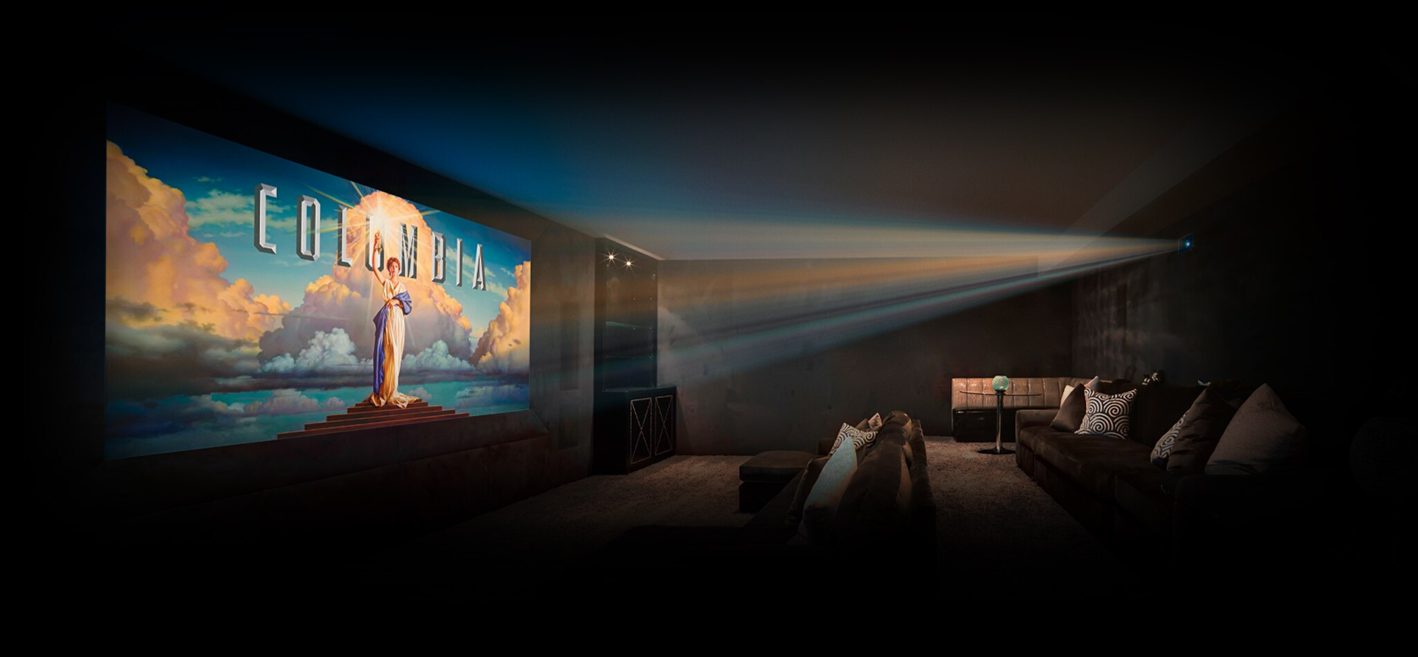 Image showing a home cinema room with a projector displaying a Columbia Pictures logo on the screen.