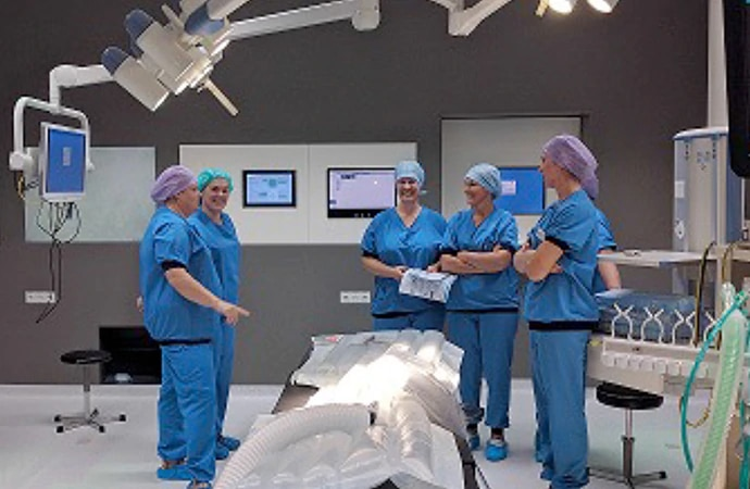 Surgical staff standing around a bed in St Jansdal hospital in Netherlands