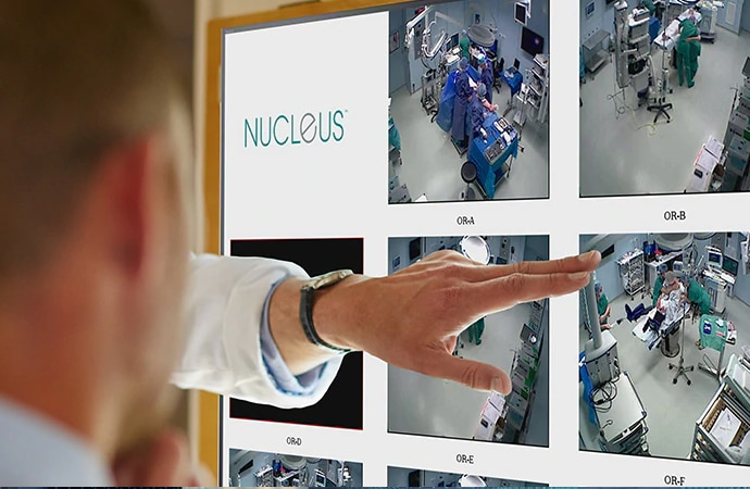 Doctors viewing a NUCLeUS mosaic view of multiple ORs on a large display