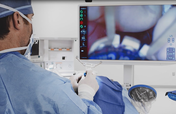Surgeon looking at a large heads up display during surgery