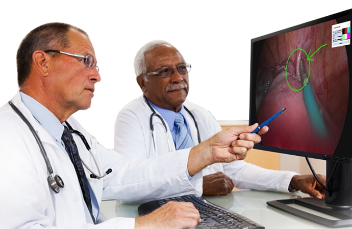 Doctors reviewing surgical footage on a desktop