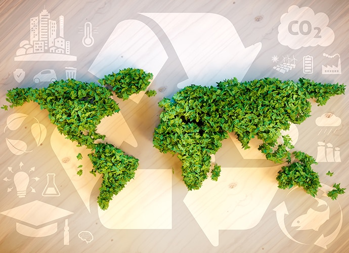 Green leaves forming the world map with a recycling arrow icon as the background