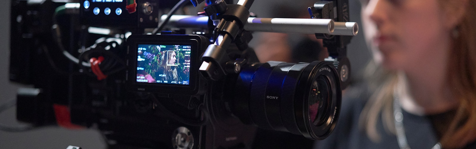 Rear-view of PXW-FX9 on shoulder of cameraman during shoot set-up