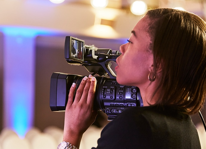 Multimedia journalist and producer Laurelle Campbell shooting with NX5R camcorder.