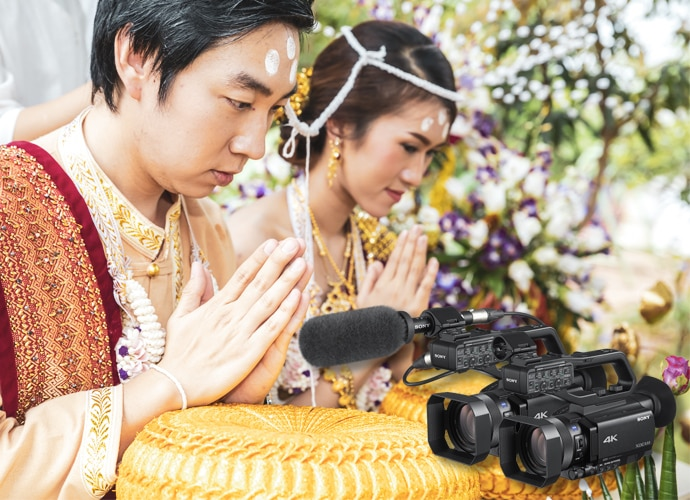Asian male and female wedding couple in traditional dress