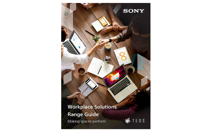 Front cover of the TEOS range guide. A bird-eye view of a meeting. Title: Workplace Solutions Range Guide, Making Spaces Perform