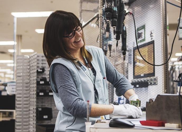female engineer fixing circuit board