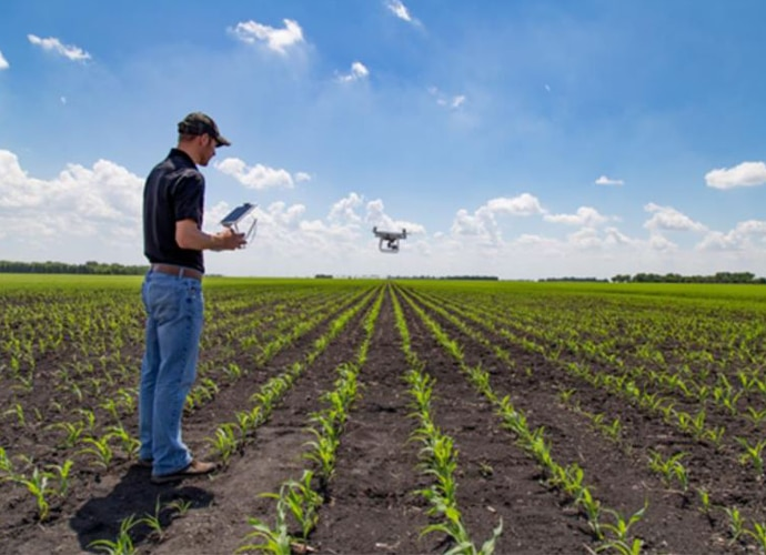 Man with drone in field