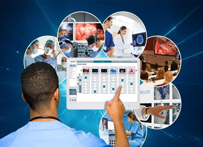 Medical professional looking at a screen showing a GUI