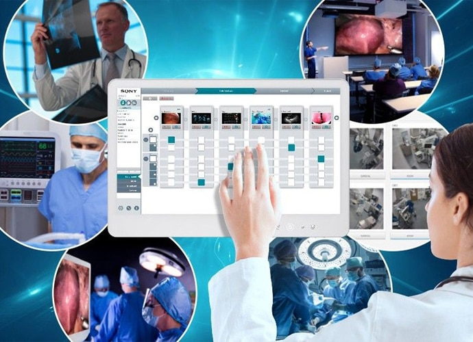 Medical professional using NUCLeUS on a touchscreen monitor.