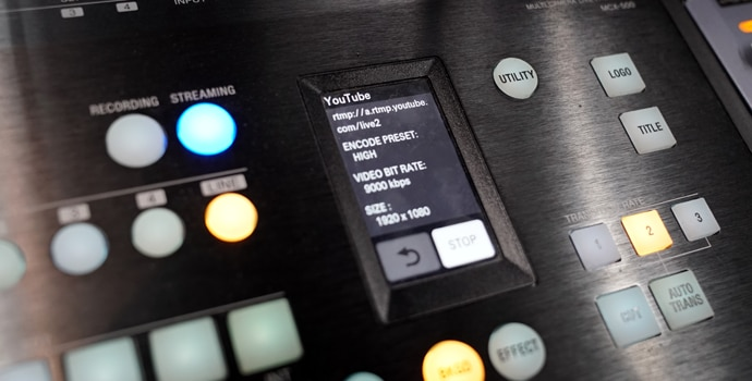 Close-up of MCX-500 with illuminated buttons and LCD touchscreen control