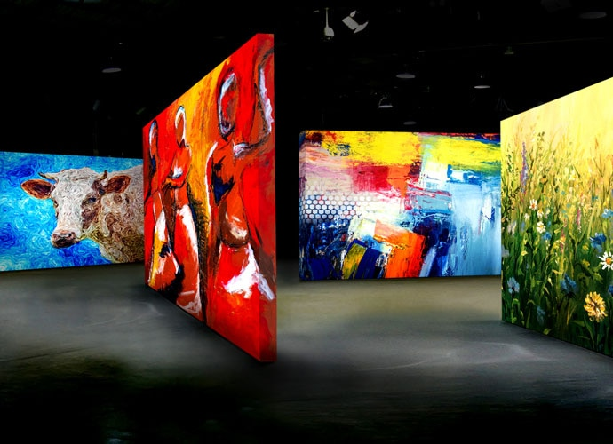 A gallery with multiple colourful projected displays