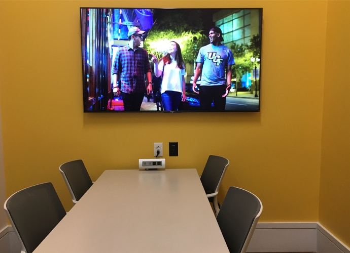 Image showing the interior of a meeting room, showing a UCF-themed image on the BRAVIA monitor.