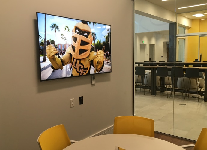 Image showing a UCF-themed image on a BRAVIA screen.