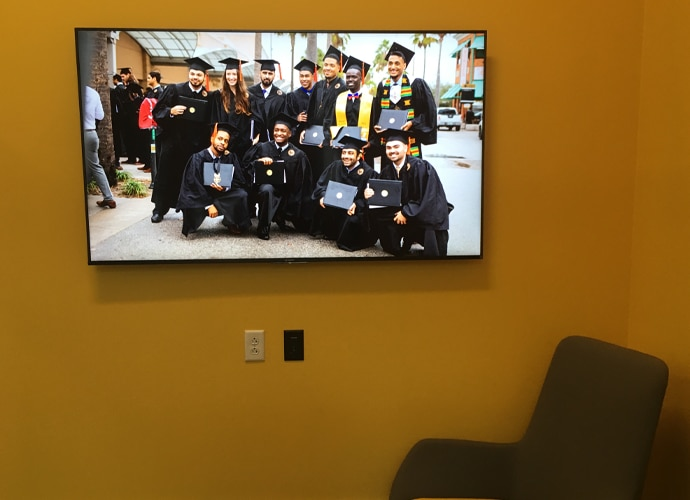 Image showing the interior of a breakout room, showing a UCF-themed image on the BRAVIA monitor.