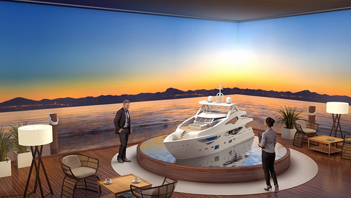 A high-end yacht showroom with a seascape projected onto the walls