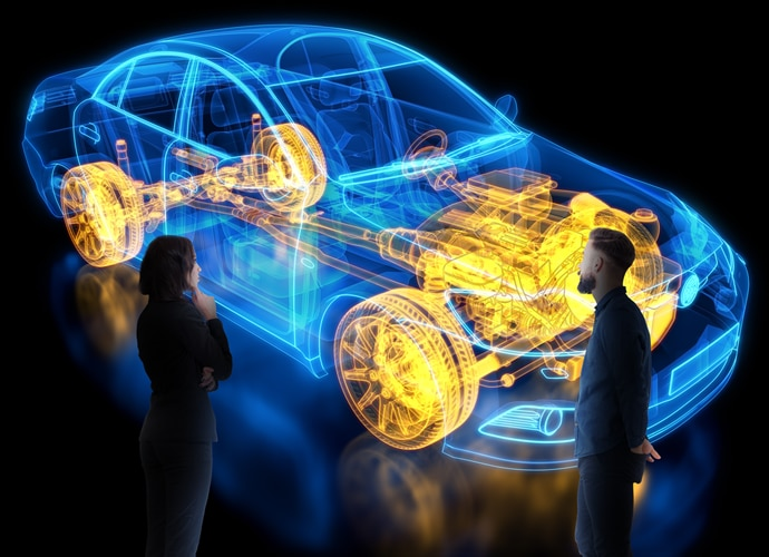 Two engineers surveying a projected CGI diagram of a car