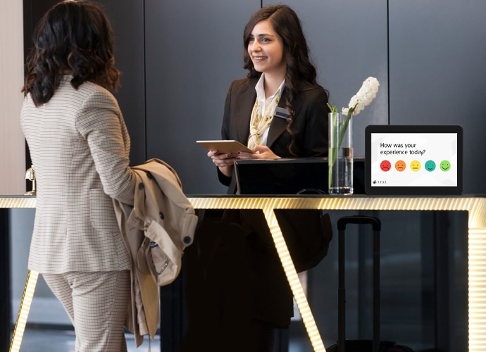 Image showing an employee asking for feedback via TEOS Survey, gathering vital information about how employees feel about their office.