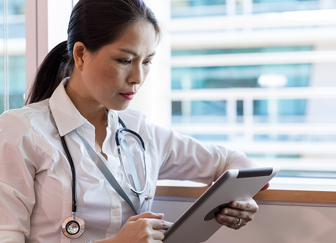 Doctor looking at a tablet device