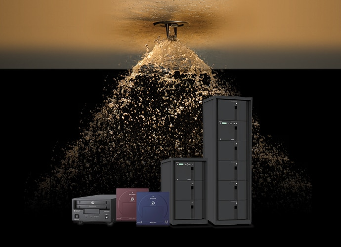 Image showing the Optical Disc Archive products under a triggered fire sprinkler