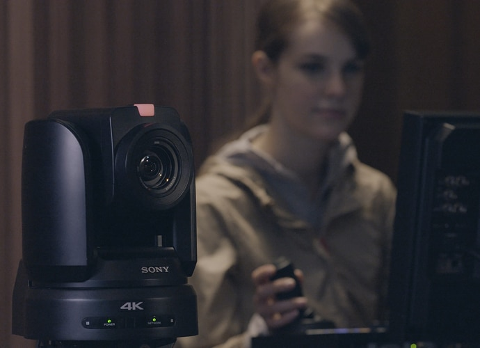 Image showing a female is utilizing the remote camera