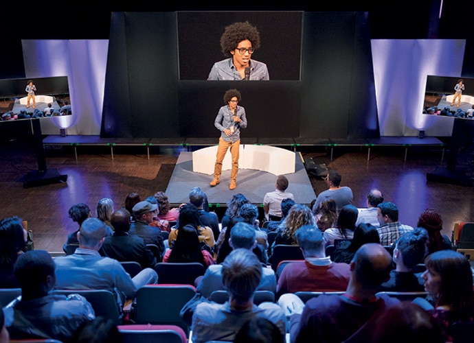 Image showing a speaker and his audience in a theatre