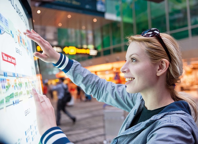 Image showing a female is utilizing an interactive display in the street