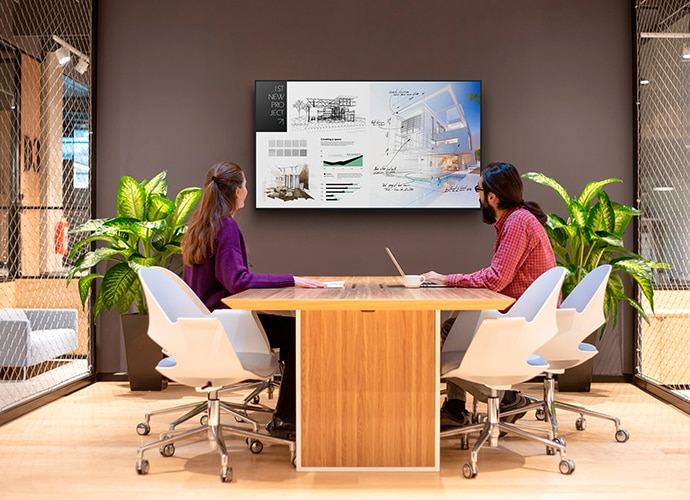 BRAVIA being used in a small conference room.
